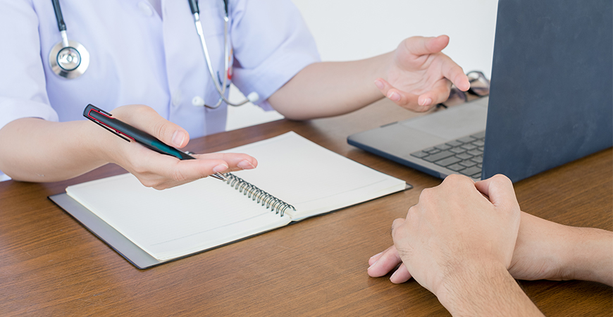 doctor physician consulting with male patients hospital exam room men s health concept