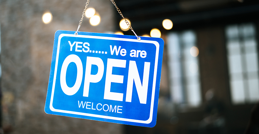 we are open sign broad through glass window restaurant